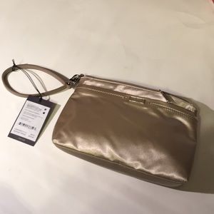 NWT Tumi Susan multifunction pouch gold